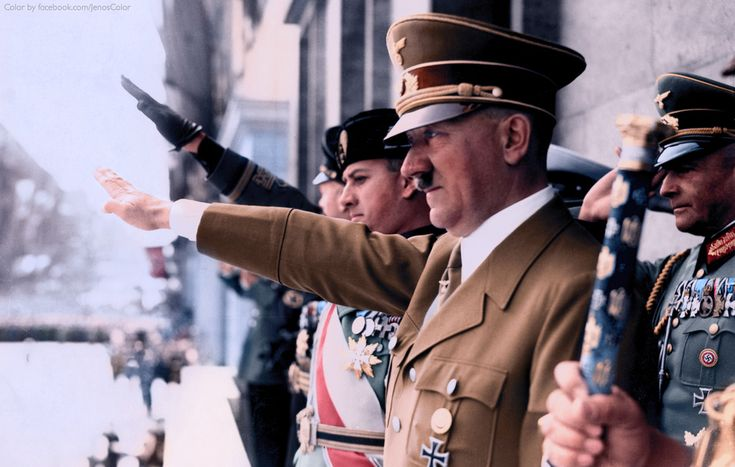 Adolf Hitler, Along with Mussolini's son-in-law, Count Galeazzo Ciano (to Hitler's right), and Joachim von Ribbentrop, attend a NSDAP (Nazi Party) rally, some time in the 1930s.
