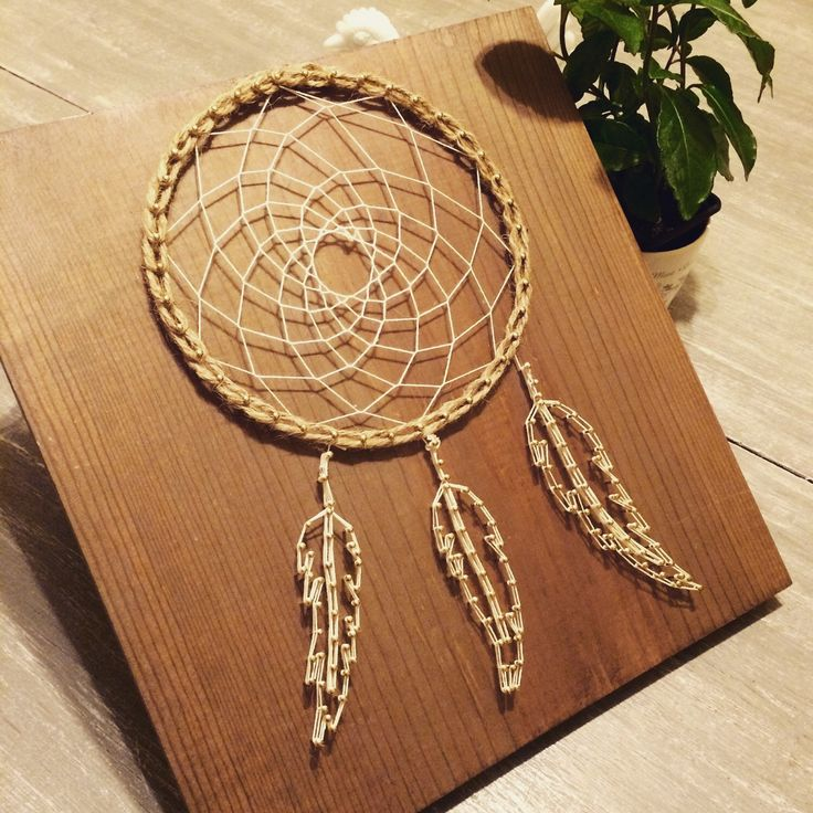 A personal favorite from my Etsy shop https://www.etsy.com/listing/268411901/dream-catcher-string-art