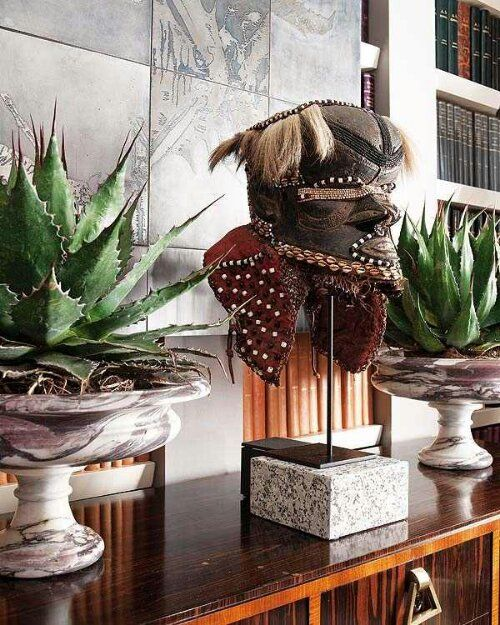African mask paired w/ matching succulents planted in granite or marble urns on each side. Stunning!
