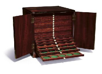 Mahogany is known to be the best material for constructing a cabinet to house valuable coins. Mahogany is now available via plantation-grown, sustainable suppliers.