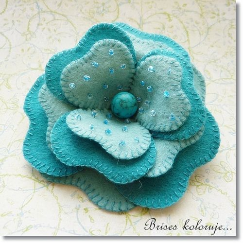 blanket stitched felt flower.
