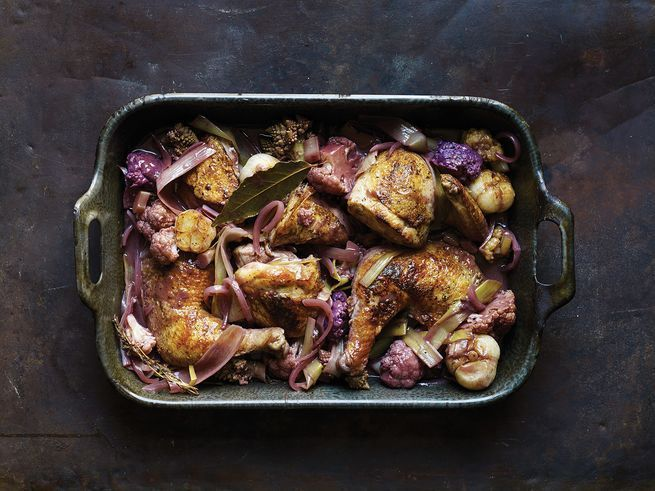 Cauliflower, leeks, and bay leaf infuse this chicken dish's luscious, reduced red wine sauce with flavor.