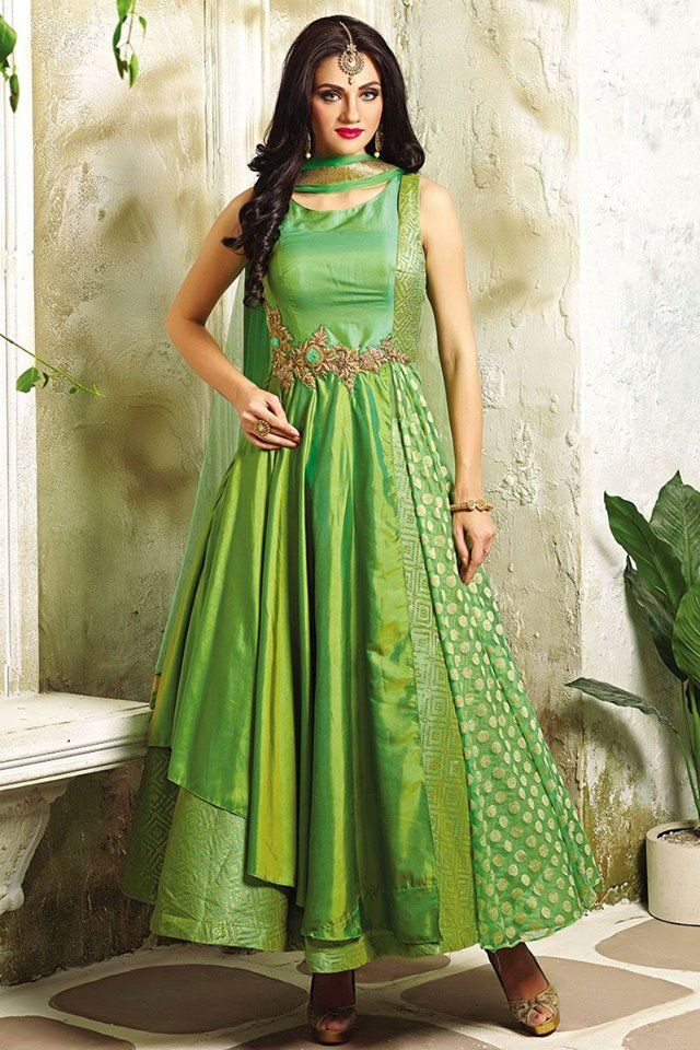 A gorgeous combination of fabrics makes this a classy Salwar Kameez outfit for any occasion! Buy Salwar Suits online - http://www.aishwaryadesignstudio.com/appealing-green-suit-with-a-fancy-flare