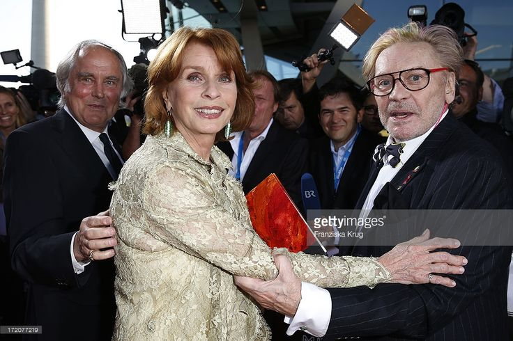 Michael Verhoeven, <a gi-track='captionPersonalityLinkClicked' href=/galleries/search?phrase=Senta+Berger&family=editorial&specificpeople=224990 ng-click='$event.stopPropagation()'>Senta Berger</a> and <a gi-track='captionPersonalityLinkClicked' href=/galleries/search?phrase=Helmut+Berger&family=editorial&specificpeople=1670005 ng-click='$event.stopPropagation()'>Helmut Berger</a> attend the Munich Film Festival 2013 - Cine Merit Award 2013 at BMW World on July 01, 2013 in Munich, Germany.