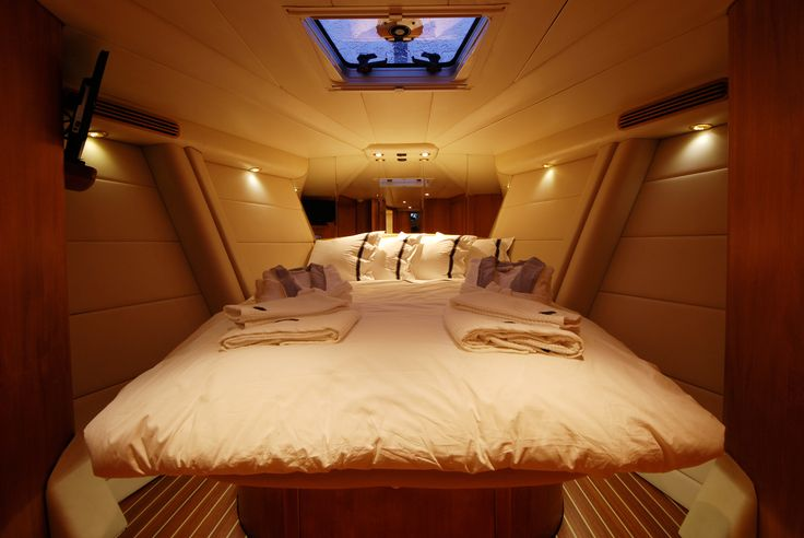 Dibley designed Commander 66 Cruising Yacht. Forward Guest Cabin. A 'floating' berth surrounded by timber and leather paneling.