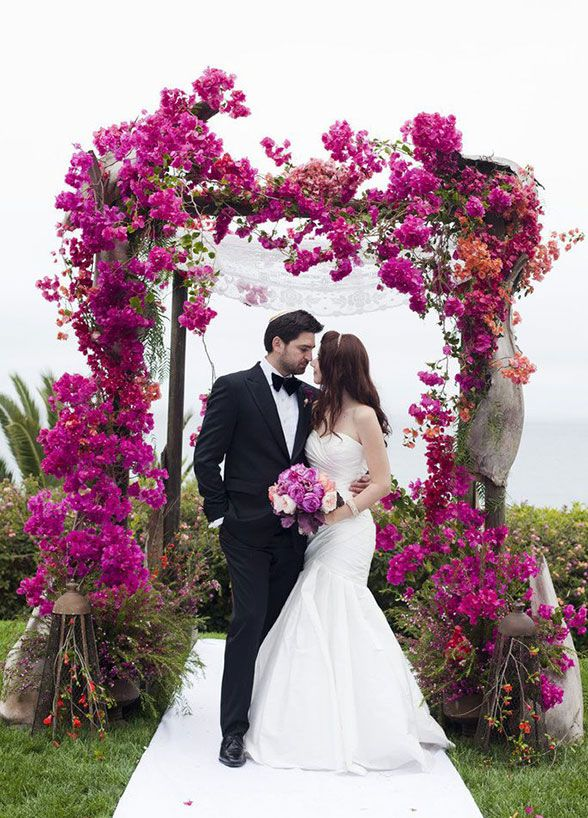 Imagine exchanging your vows underneath a wedding arbor that makes it look as if you've stumbled upon a secret garden.