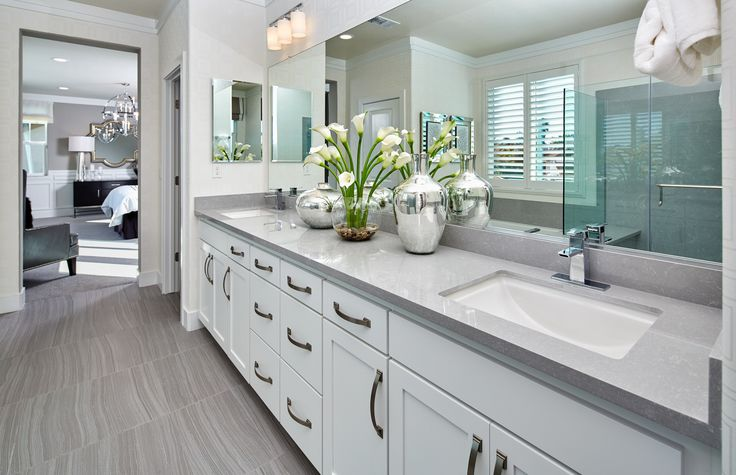 Shades of gray and white will make for a beautiful, open-feeling vanity area in your master bathroom! | Pulte Homes