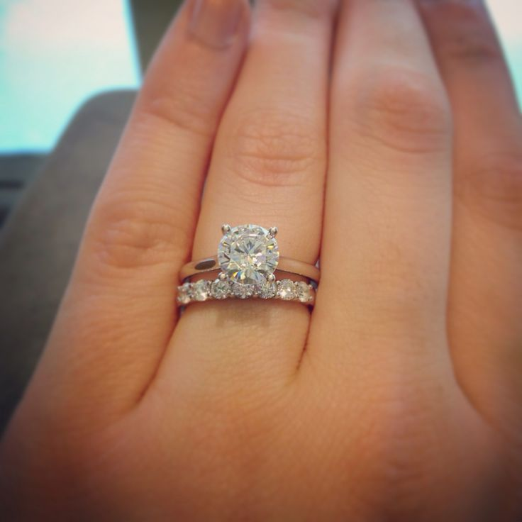 Classic 1.5 carat round solitaire. Paired with an 18kw  .55 carat wedding band #HuffordsJewelry