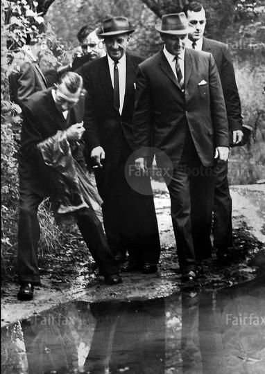 Detectives, police and counsel searching the area where the bodies were found. From left to right Mr J. J. Loomes, Mr Kevin Murray, barrister, Det. Insp. Ron Watson, Det. Sgt. G. Lindsay, A. D. Collins, barrister. Taken on 9 May 1963. SMH NEWS Picture by N HERFORT