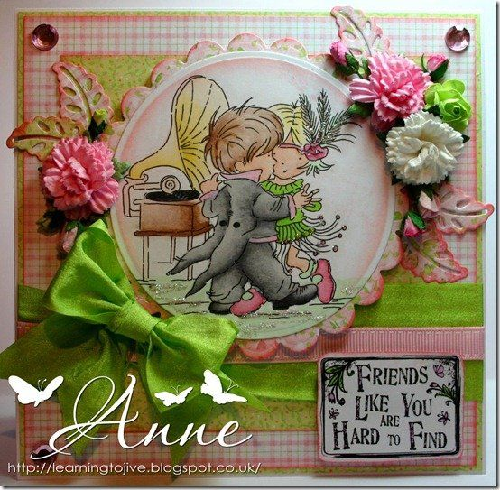 handmade greeting card ... Lily of the Valley image of a little guy and his gal in Roaring 20s garb dancing to gramophone music ... luscious chartreuse bow .. artificial flowers ... layered circle and scalloped circle for the focal point ... tiny pink plaid background paper ... delightful!!: