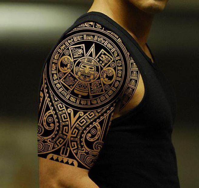 Beautiful black ink god sun aztec prehispanic period tattoo on shoulder