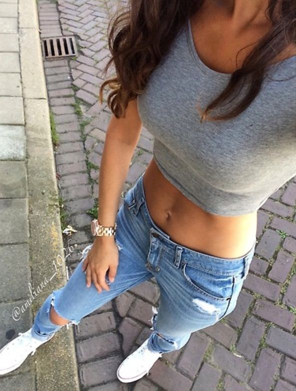 White converse. Ripped Jeans. Grey crop top. Casual cute, good option for this weekend.