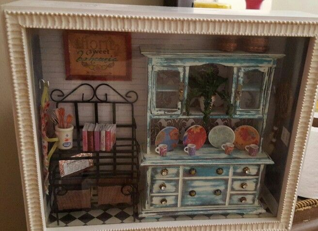 Boho chic miniature dollhouse room box. Apron, dream catcher, distressed hutch, bohemian print dishes and cups. Miniature wire bakers rack. Picture says home sweet bohemia. I distressed pre-made hutch, placed black and white patterned paper inside, mod podge dishes, made apron, cookbooks, wooden spoons and wire whisk.