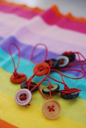 Metamorphosis - cute easy stitch markers. Looks easy to make by using a pony tail band and buttons.