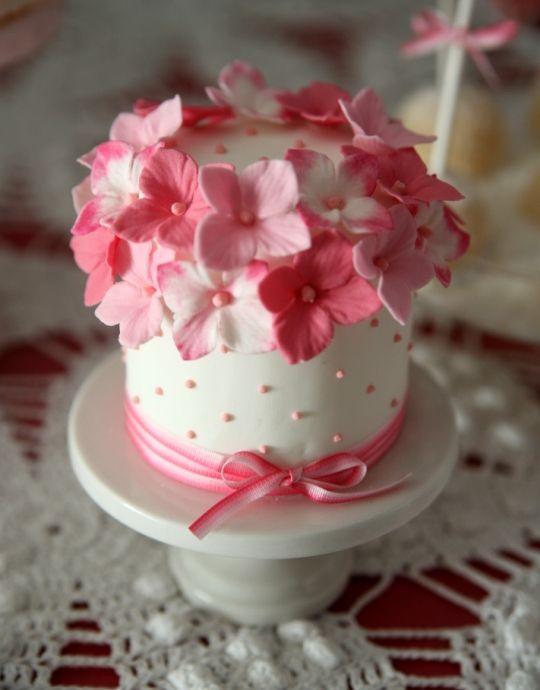 cute mini cake covered in pink flowers