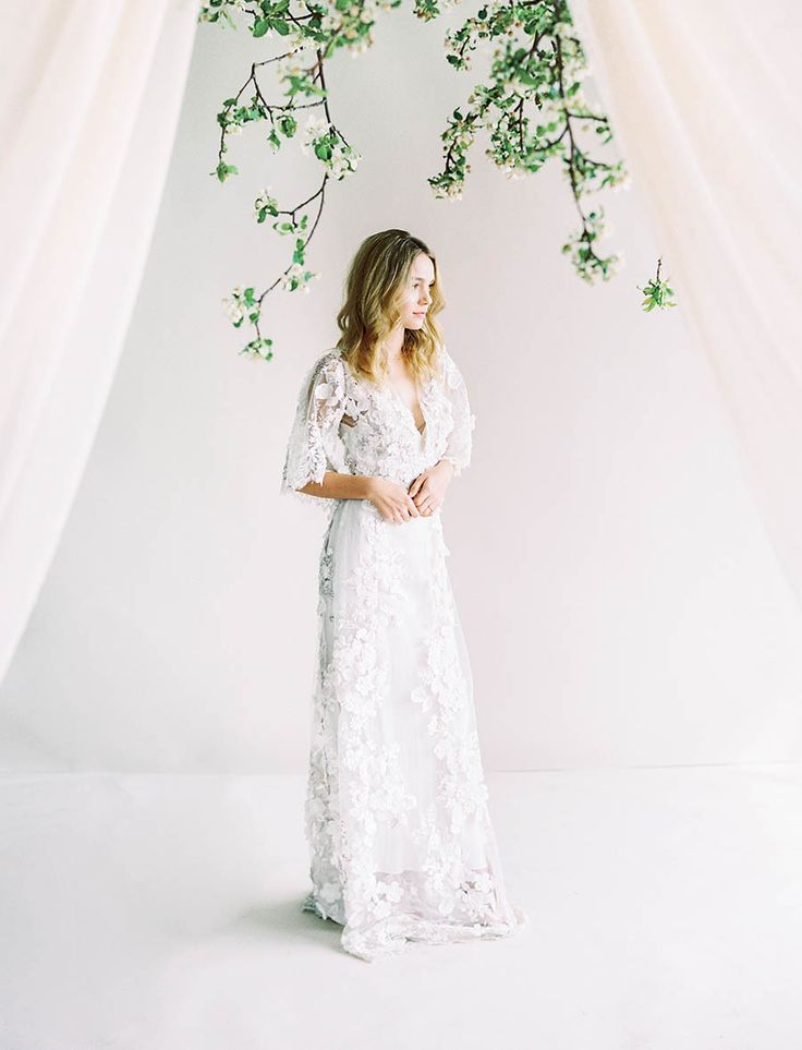Lace butterfly sleeve wedding dress | Photography: Sally Pinera