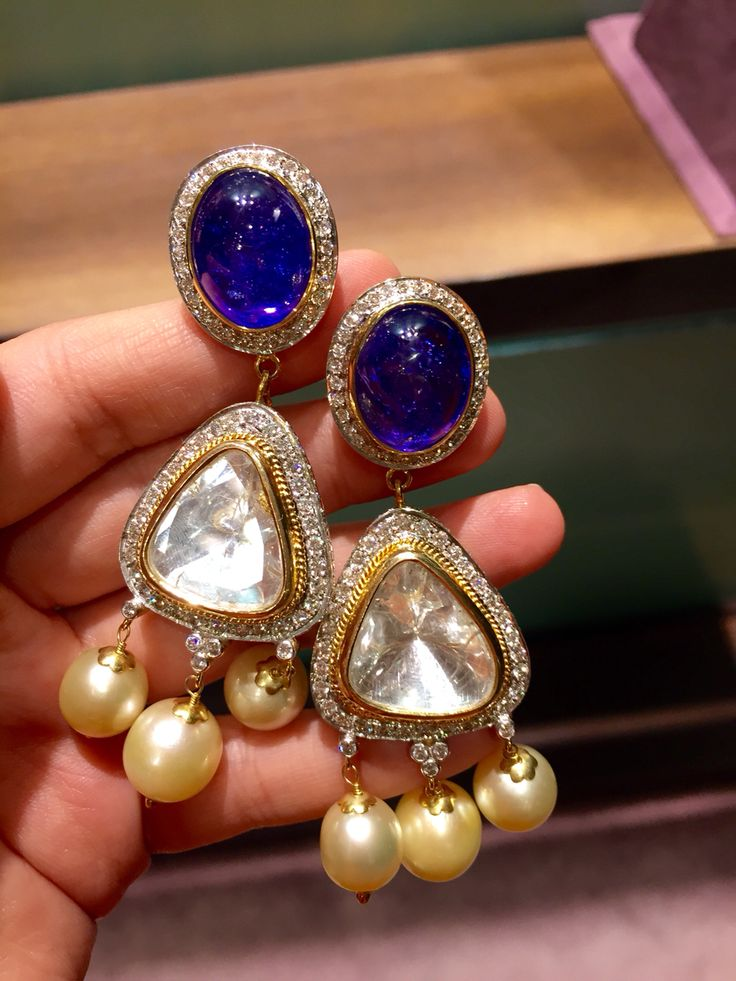 Deep blue tanzanite earrings with diamonds, south sea pearls and big uncut diamonds.by Rakesh Khanna.
