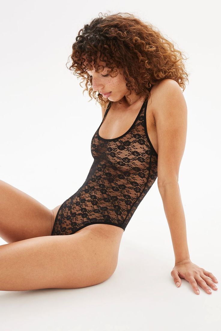 We love the gothic glamour of this black lace strappy body. Pair with a black bra and high-waisted mom jeans for a quentessentially '90s look.