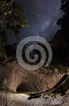 MILKY WAY TUNNEL -  This place is a National Park with this natural tunnel entrace to the canyon. The park's most important geologic features are Cheile Bicazului (Bicaz Gorges), a deep canyon dug by the Bicaz River, Lacu Roşu (the Red Lake) - a natural dam lake, and the Hăşmaş Mountains.  Download From Over 25 Million High Quality Stock Photos, Images, Vectors. Sign up for FREE today. Image: 42995405
