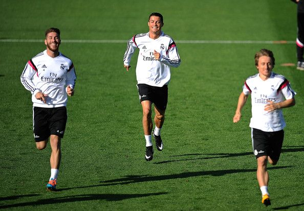 Sergio Ramos Photos Photos - Cristiano Ronaldo, Sergio Ramos and Luka Modric of Real Madrid CF warm up during a team training session the day before their La Liga match against FC Barcelona at Ciudad Deportivo Real Madrid on October 24, 2014 in Madrid, Spain. - Real Madrid CF Training Session