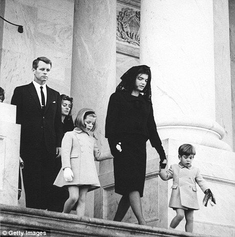 Members of the Kennedy family leave the US Capitol following a brief service, leaving the body of assassinated President John F. Kennedy