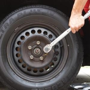A torque wrench is a necessity for changing a tire. Improperly torqued lug nuts can cause expensive brake problems and also break wheel studs.