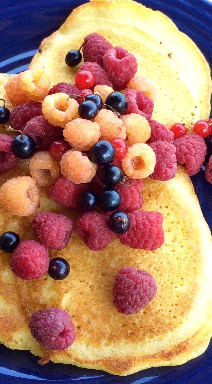 Russian Pancakes made with Kefir, topped with Fresh Berries (Оладики). A healthier and tastier way to make pancakes.
