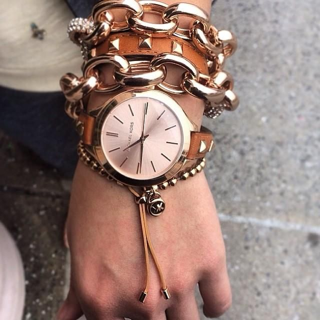 Styling tip: Wrap a necklace as a bracelet and layer, layer, layer.