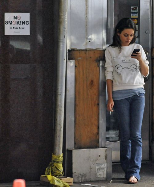 mila kunis - this picture is funny for all the wrong reasons. Anyway, I love her jumper. It looks cute