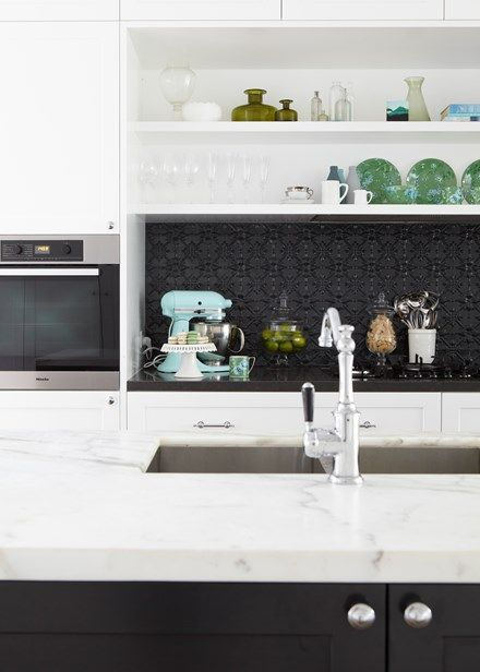 Black and white family kitchen with striking finishes