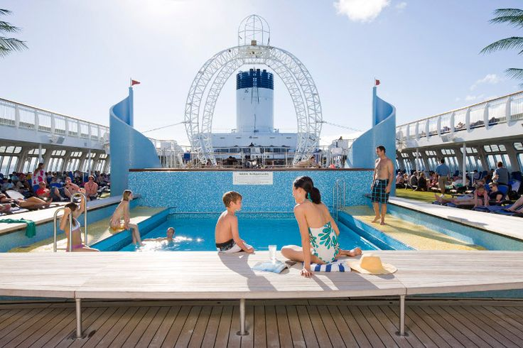 Carnival Australia - P Cruises - Pacific Jewel passengers relax by the pool.  Passengers soak up the sights and sounds by the pool on Pacific Jewel.