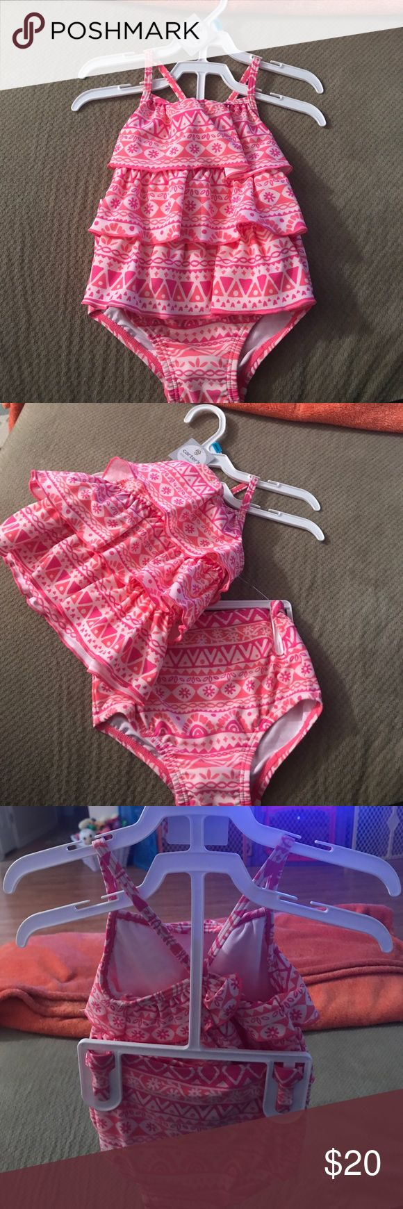 BNWT LITTLE GIRL TANKINI!! Super cute pink tankini!! Has a on the back top!! Absolutely adorable! Sadly it is way too big for my daughter! Carter's Swim Bikinis