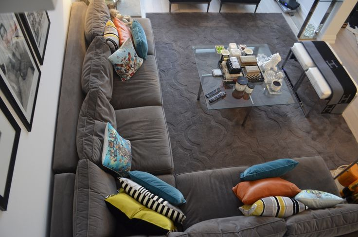 Aerial view of a gorgeous L-shaped couch. Everything about this living space just screams fabulous and inviting.