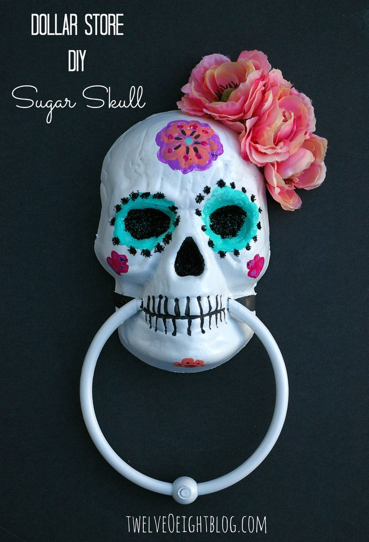DIY Dollar Store Painted Sugar Skull: I bought one of these from Dollar Tree and thought about painting it, this is pretty.