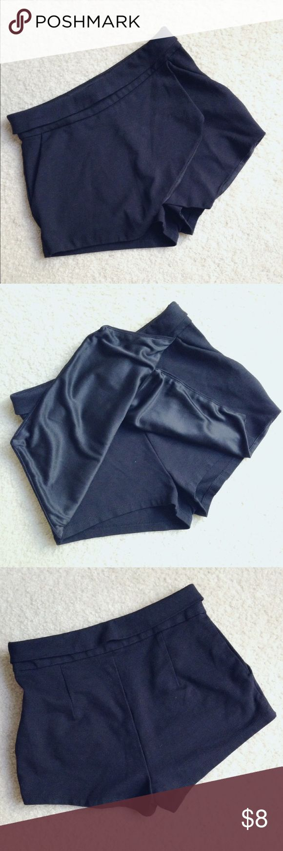"""Skirt -like shorts Black short with a skirt-like front, (back is pure short-look), invisible side zipper, two front pockets. 68% rayon, 27% nylon, 5% spandex, material has some thickness( feels like the material of suites), very very short length, inseam 1 3/4"""", junior size S. Waist approx 13 1/2"""". Brand is Active USA designed in Los Angeles Active USA Shorts"""