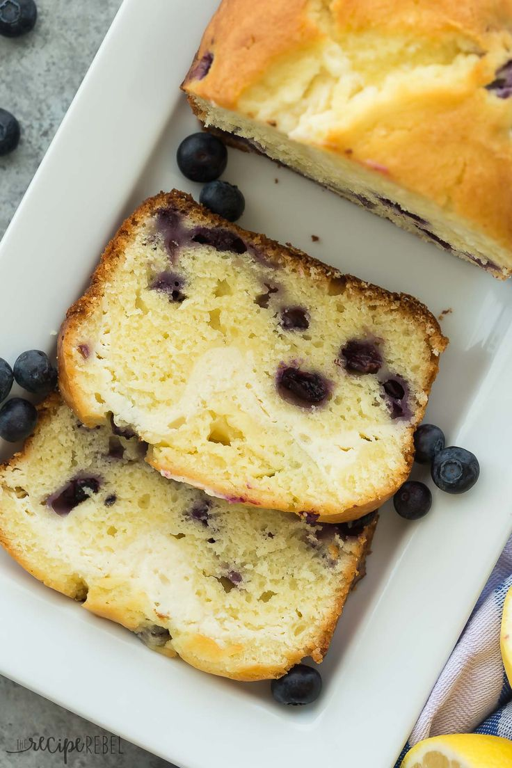 This Cream Cheese Filled Blueberry Lemon Bread is sweet, tangy and filled with a decadent cheesecake layer! Let's call it breakfast or dessert ;) Includes how to recipe video | lemon recipe | berries | summer | baking | breakfast recipe | cheesecake