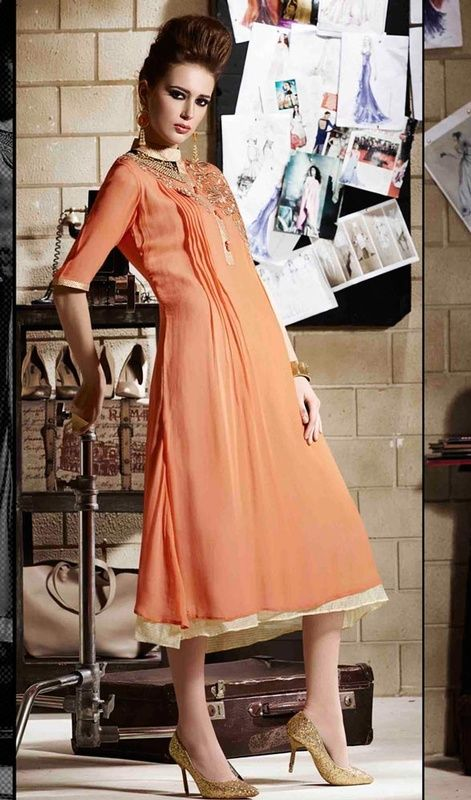 Bedazzle your looks dolled up in this orange color embroidered georgette Anarkali style tunic. The lace, resham and patch work looks chic and great for any get together. #flaretunic #anarkalistyletunic #embroideredtunic