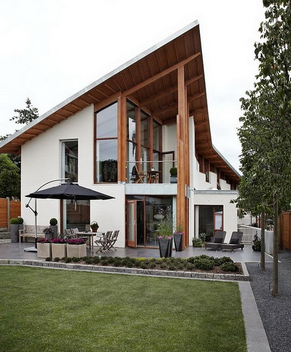 modern Scandinavian home design. I like the roof and the glass frontage opening to the balcony.