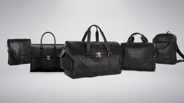 The New Globe Traveller Bags include a ladies' tote, a messenger bag, a laptop/business bag, a backpack, and a weekend holdall.