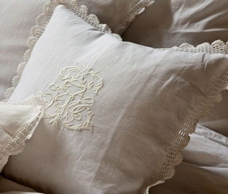 A decorative pillow with regal embroidery in the center, with a seam-to-seam finish and crocheted lace border. It is shown here in White. * Contact your local retailer or designer for pricing, fabrics and product options.