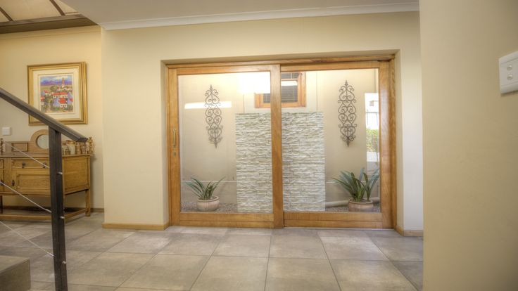 Lots of living space for the family #interior #decor #design #interiors #paarl #southafrica #lifestyle #luxury #doors