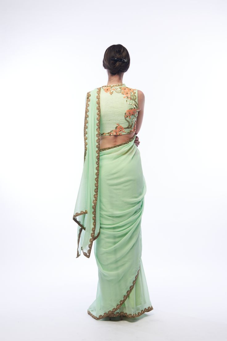 "Pistachio saree in flat chiffon with 1.5"" embroidered border, a satin skirt, and…"