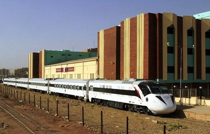 Sudan's new Nile Train passes through Khartoum. In a dilapidated, poverty-stricken country where some railway rolling stock is more than 40 years old, Sudan's sleek, sharp-nosed Nile Train is an unusual sight.  From a distance it looks like a large white snake gliding past fields of green near the Nile River north of Khartoum.