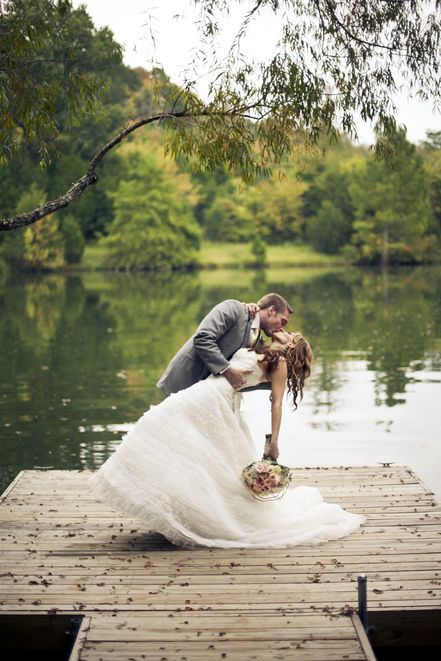 Gorgeous bride and groom kissing shot on the lake