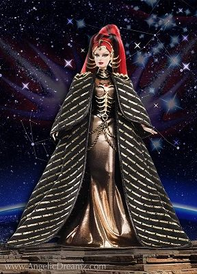 Queen of the Constellations Barbie Doll Fantasy  Special Occasion Collection. 2013.  Regally dressed in a golden metallic dress with a bejeweled corset and dramatic black metallic-striped cape, the Queen of the Constellations Barbie doll is a commanding presence. Unique golden embellishments include a futuristic flared crown, collar adornment, and intricately shaped epaulets. This doll is the third  and final in the futuristic space goddess series.