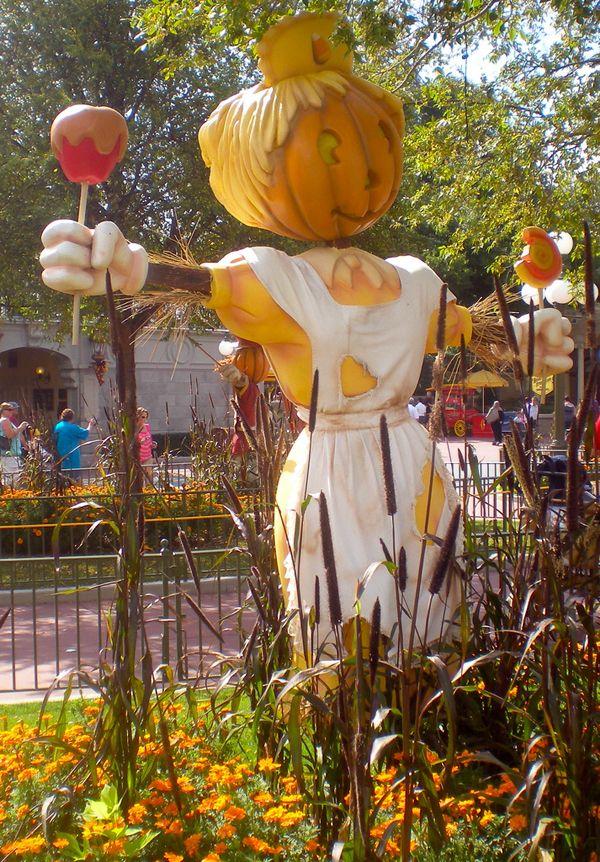 candy toting scarecrow at the magickingdom halloween at disneyworld - Disney World Halloween Decorations