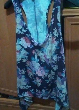 Kup mój przedmiot na #vintedpl http://www.vinted.pl/damska-odziez/koszulki-z-krotkim-rekawem-t-shirty/14525348-koszulka-z-kwiatowymi-wzorami-rozmiar-l