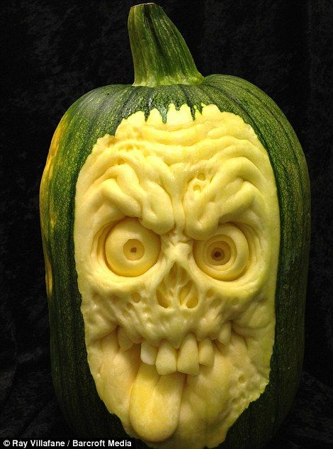 A horror face carved out of a pumpkin by Ray Villafane and team