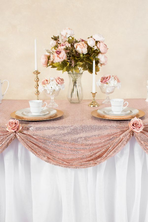 Our frilly tutu table skirt is elevated to an extreme level of elegance in our Vintage Luxe Wedding Tablescape featuring our lovely sequin blush tablecloth.