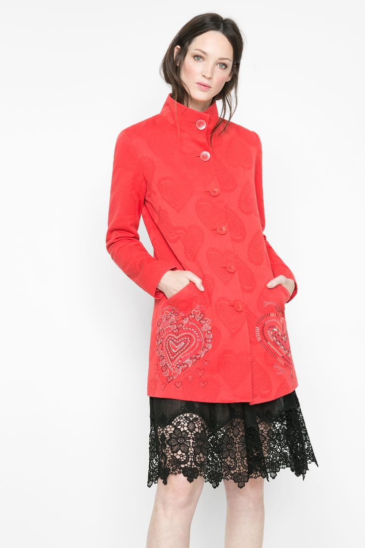 This red coat has a jacquard heart shaped print and embroidered heart shaped details on the front. Feel the love!